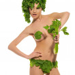 图库照片: Sexy woman with clothes made ??of vegetables