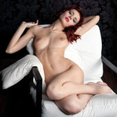Naked woman on the armchair — Stock Photo