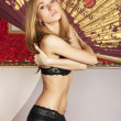 Sensual young woman in black lingerie — Foto Stock