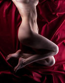 Beauty naked body on red — Stock Photo
