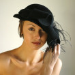 Girl in a black hat — Stock Photo